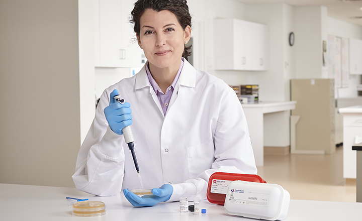 Microbiologist using Test-Ready Control Strains